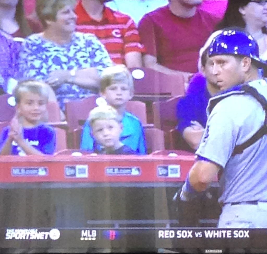 A.J. Ellis's son claps after his dad throws out a would be base stealer. August 26, 2015.