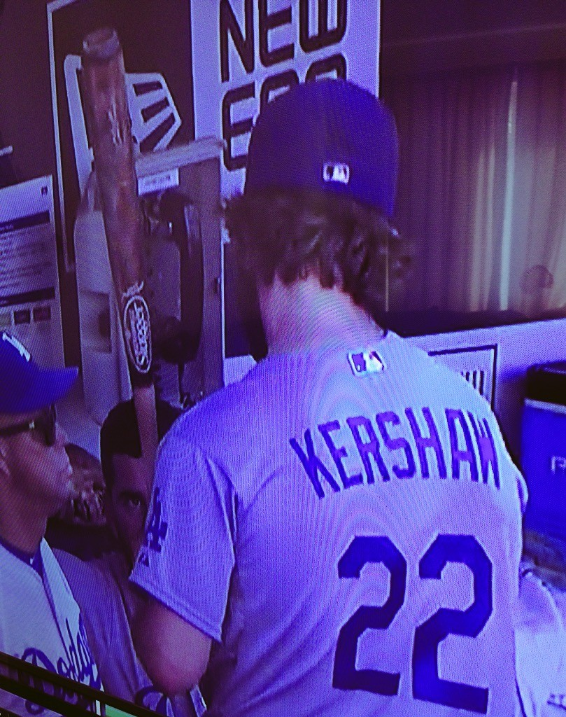 Clayton Kershaw grabs a bat in the dugout. September 6, 2015.