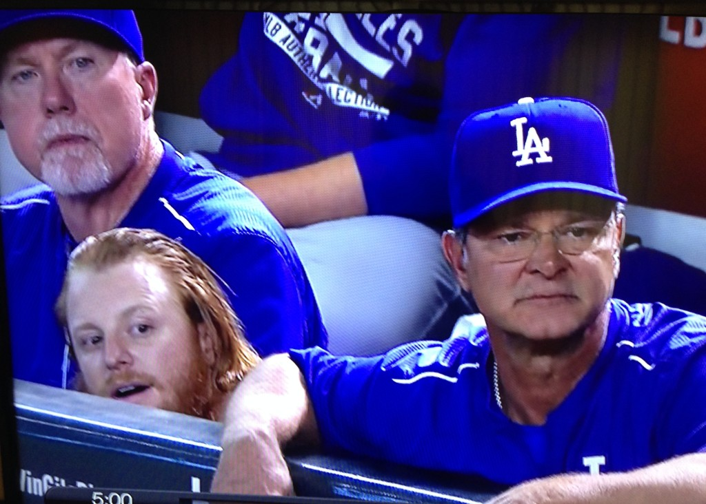 Justin Turner, Don Mattingly and Mark McGwire from the dugout. September 12, 2015.