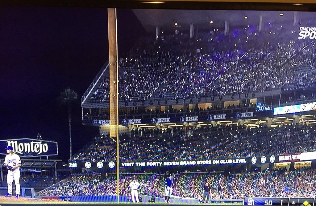 Fans at Dodger Stadium hold their lighted cell phones up for Zack Greinke. October 3, 2015.